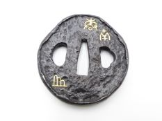 A SHOAMI IRON TSUBA, INCISED AND SET WITH GOLD CHARACTERS