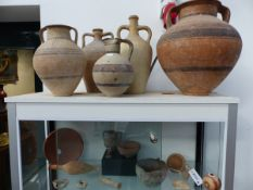 A COLLECTION OF ARCHAIC POTTERY VASES AND OTHER ARTIFACTS