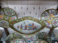 A CHINESE ROSE CANTON SHAPED OVAL FORM FOOTED SERVING DISH. 40CM LONG