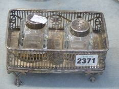 A GEO.III. SILVER RECTABGULAR INKSTAND WITH PIERCED NEO CLASSICAL BORDER ON CLAW AND BALL FEET,