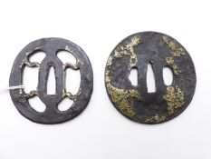 TWO IRON TSUBA, THE FIRST PIERCED AND HIGHLIGHTED WITH GILT, THE SECOND DECORATED WITH A STYLISED