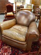 A GOOD QUALITY EARLY 20TH.C.LEATHER UPHOLSTERED CLUB ARMCHAIR