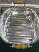 A VICTORIAN SILVER BACON DISH WITH IVORY SIDE HANDLES AND GRILL, DATED SHEFFIELD, 1859, BEARS
