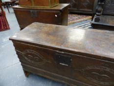 A 17TH.C.OAK PLANK COFFER WITH CARVED FRIEZE AND A SIMILAR PLAIN OAK PANEL COFFER. 93cms AND