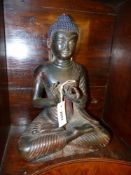 AN ORIENTAL PATINATED BRONZE FIGURE OF BUDDHA WITH TRACES OF GILT AND POLYCHROME DECORATION. 38CM