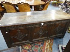 AN 118TH.C.OAK LARGE BLANKET CHEST / COFFER WITH CARVED PANELS AND FRIEZE. 163cms WIDE