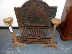 A 19TH CENTURY CAST IRON FIRE BACK, GRATE AND DOGS