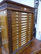 A VICTORIAN OAK COLLECTOR'S CHEST OF FOURTEEN SHALLOW DRAWERS WITH CARVED IVORY HANDLES. 56cms