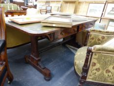 A ROSEWOOD AND LEATHER INSET LIBRARY WRITING TABLE