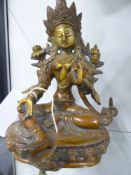 AN EASTERN BRONZE FIGURE OF A SEATED DIETY ON A LOTUS FORM BASE. 21CM HIGH