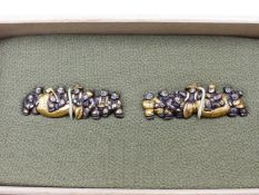 A FINE PAIR OF SHAKUDO MENUKI, HIGHLIGHTED IN GOLD AND DEPICTING SEVEN LAUGHING FIGURES, ONE ATOP