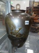 AN UNUSUAL EARLY 20TH CENTURY JAPANESE BRONZE VASE WITH RELIEF DECORATION OF A SAMURAI HELMET,