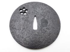 A MUROMACHI PERIOD LARGE IRON TSUBA PIERCED WITH A SINGLE BLOSSOM. LATE 14TH CENTURY - LATE 16TH