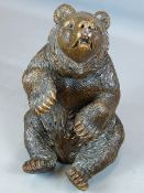 AN UNUSUAL FINELY CARVED BLACK FOREST FIGURE OF A SEATED BEAR WITH GLASS EYES AND BRASS TRADE LABEL,