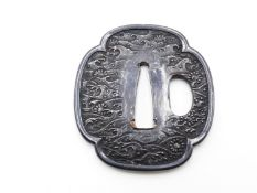 A 19TH CENTURY SHAKUDO TSUBA, FINELY DECORATED WITH A WAVE PATTERN OVER ALL