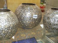 THREE SILVER GLOBULAR VASES WITH MULTI FLOWERHEAD DECORATION, STAMPED AA.900, 20cms HIGH