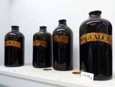 FOUR LARGE 19TH.C.GREEN GLASS APOTHECARY BOTTLES WITH GILT LABELS.