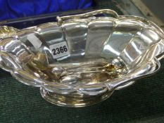 A SILVER CAKE BASKET WITH FOILED RIM, SWING HANDLES, SHEFFIELD, 1912, 18ozs TOGETHER WITH A CASED