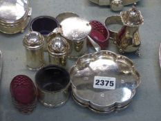 THREE SILVER OCTAGONAL COASTERS, LONDON 1965, 13ozs TOGETHER WITH VARIOUS TABLE CRUETS,ETC. (12)
