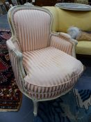 A NEAR PAIR OF FRENCH TUB ARMCHAIRS AND A SIMILARLY UPHOLSTERED FOOTSTOOL