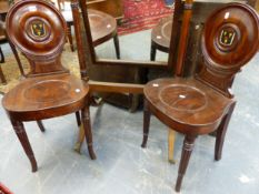 A GOOD PAIR OF LATE GEORGIAN MAHOGANY HALL CHAIRS WITH PAINTED ARMORIAL PANEL BACKS.