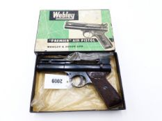 A WEBLEY PREMIER AIR PISTOL, IN .22 CALIBRE, SERIAL NO 121, CONTAINED IN ITS ORIGINAL BOX WITH