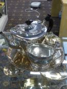 A SILVER THREE PIECE TEA SET, SHEFFIELD 1926, 32ozs ALL IN AND A SILVER SALVER, LONDON,1915, 25cms