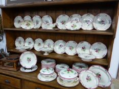 AN EXTENSIVE GIEN FRENCH PART DINNER SERVICE WITH FLORAL DECORATION