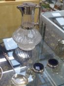 A SILVER PLATED MOUNTED GLASS CLARET JUG,IN THE MANNER OF CHRISTOPHER DRESSER