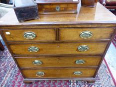 A SMALL GEORGIAN MAHOGANY CHEST OF TWO SHORT AND THREE LONG GRADUATED DRAWERS ON OGEE BRACKET FEET