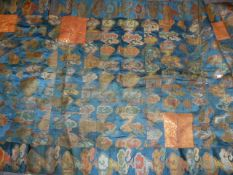 A JAPANESE SILK PATCHWORK PANEL WITH CLOUD MOTIFS ON A BLUE FIELD