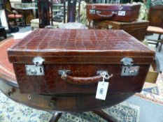 AN EARLY 20TH. CENTURY CROCODILE SKIN SUITCASE WITH MAKERS STAMP THE MANDA CLARK AND CO LIMITED