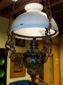 A LATE VICTORIAN HANGING CHANDELIER WITH CERAMIC AND GLASS OIL RESERVOIR.
