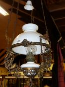 A VICTORIAN HANGING OIL LAMP WITH WHITE POTTERY RESERVOIR.