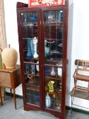 VINTAGE LEADED GLASS MAHOGANY TWO DOOR BOOKCASE. BY ARMSTRONG VICKERS.