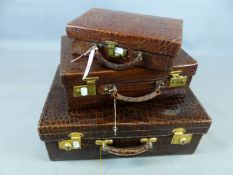 AN EARLY 20TH. CENTURY CROCODILE SKIN SUITCASE WITH SILK LINING AND CANVAS OUTER TOGETHER WITH TWO