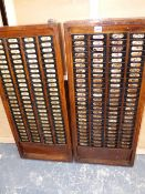 A PAIR OF ANTIQUE CLOCKING-IN CARD BOARDS, NUMBERED 1-200.`