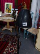 AN ANGLEPOISE TYPE LAMP ON WHEELED BASE.