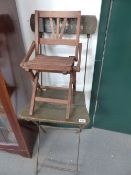 A MINIATURE FRENCH FOLDING CHAIR AND AN IRON FRAMED FOLDING CHAIR.