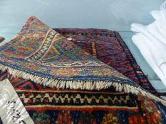 AN ANTIQUE PERSIAN TRIBAL BAG AND TWO SIMILAR BAG FACES.