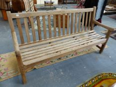 A LARGE TEAK GARDEN BENCH COMMEMORATING THE CORONATION OF GEORGE VI 1937. 183CMS.WIDE