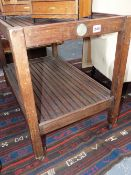AN EARLY 20TH.C.TEAK TWO TIER SERVING TROLLEY, CONSTRUCTED FROM THE TIMBERS OF HMS ARETHUSA.
