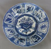A LARGE CHINESE KRAAK BLUE AND WHITE SAUCER DISH. DIAMETER 50CMS.