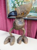 AN UNUSUAL HARDWOOD FIGURE OF A BIRD WITH GLASS EYES.