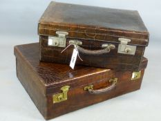 AN EARLY 20TH. CENTURY CROCODILE HIDE SKIN SUITCASE WITH ORIGINAL CANVAS OUTER AND BRASS CLASPS