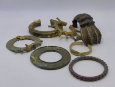 A GROUP OF SEVEN VARIOUS WEST AFRICAN BRASS AND BRONZE CURRENCY BRACELETS.