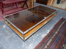 A CONTEMPORARY CHROME AND GLASS COFFEE TABLE WITH WALNUT BASE.