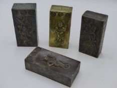 FOUR EASTERN BRASS PRAYER TABLETS ? EACH DECORATED WITH EMBOSSED DEITIES AND SCRIPT.