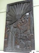 A CARVED AFRICAN TRIBAL PANEL DEPICTING HARVESTING FIGURES. 72X42CMS.