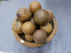 TWO TRIBAL MADE WOODEN DEEP BOWLS AND AN EASTERN IRON BOUND WOODEN BUCKET CONTAINING A LARGE